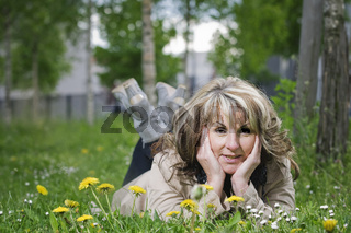 Mature woman on the meadow