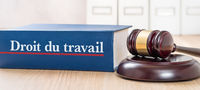 A law book with a gavel - Labour law in french - Droit du travail