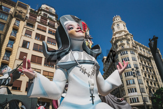 Happy comic figurine of a prayping nun for the Fallas celebration in the 'Av. de Maria Cristina' in Valencia, Spain