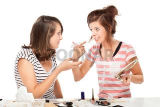 Two  teenage girl  putting on make-up
