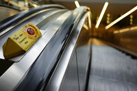 Empty escalator with emergency stop at airport frankfurt rhein main during corona pandemic