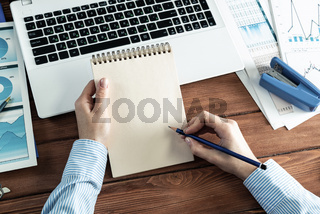woman with notepad in the office