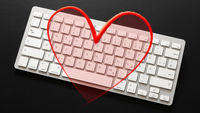 typical computer keyboard with a red heart overlay