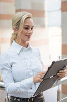 Beautiful businesswoman uses a digital tablet