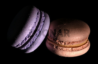 Two macaroons darkened in black