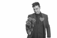 Studio shot of Caucasian businessman giving roses ready for Valentine's day