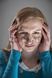 Woman in migraine vertical
