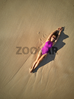 Woman on beach at Seychelles aerial top view