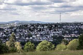 City of Siegen in the green belt with university and transmission tower