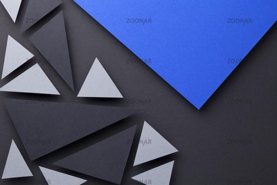 Modern Triangular Shapes Composition Over Black Paper
