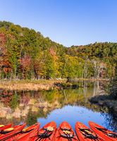 Red canoes moored on the lake