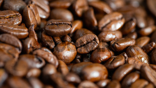 Close-up of roasted coffee beans in detail.