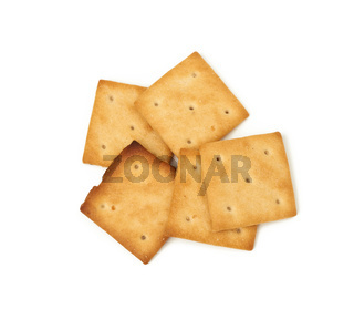 baked square crispy cracker cookies isolated on white background