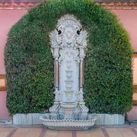White marble sculpted wall fountain and green leaves, Sultan Ahmed square, Istanbul, Turkey