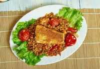 Harissa crumbed fish with lentils
