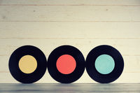 Three Vinyl records yellow red and blue