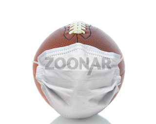 Sports and Covid-19 Concept.  End shot of an american Foortball with a surgical mask.