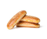 baked oval hot dog bun, baked goods sprinkled with sesame seeds and isolated on white background