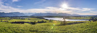 panoramic scene at Bavarian alps mountain range and lake Riegsee