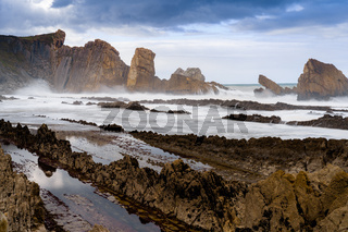 A rocky and wild coast with stormy waves hitting the shore