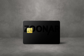 Black credit card on a concrete background