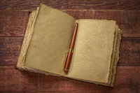 antique leatherbound journal on rustic wood