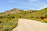 Crete island mountains and winding road. Asphalt road in a natural landscape.