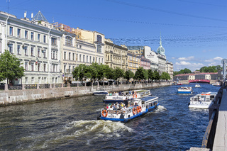 Pleasure and sightseeing boats with tourists. Saint Petersburg, Russia.