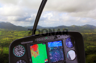 Wilderness view from inside a low flying helicopter
