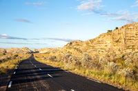 An asphalt road through the landscape of the island of Madagascar
