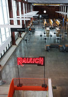 RALEIGH,NC/USA - 3-21-2020: The interior of Union Station train depot in Raleigh, NC, with a neon Raleigh sign