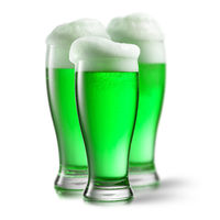 Alcoholic green beer in the glasses on a white.