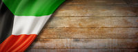 Kuwaiti flag on vintage wood wall banner