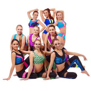 Charming young fitness girls posing at camera