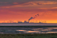Dramatic Sunset at Wadden Sea With Wind Turbines in the Background, East Frisia, Germany