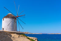 Old white windmilll by the sea in Mykonos
