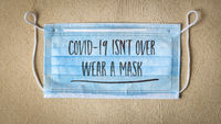 covid-19 is not over, wear a face concept
