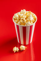 Sweet popcorn in striped paper cup.