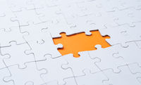 Empty white jigsaw puzzle with  missing pieces