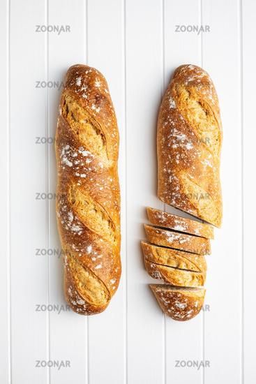 Crispy fresh baguettes. Sliced baguette.