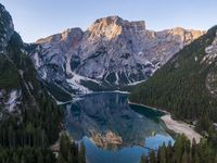 Aerial view of the beautiful reflection of Seekofel mountain in Lake Braies at sunrise, Italy