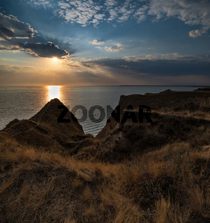 Sunset Stanislav clay mountains and canyons above Dnipro river bay, Ukraine