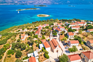 Lumbarda. Korcula island vllage of Lumbarda church and coastline aerial view