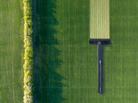 Green field with disposable shaving machine.