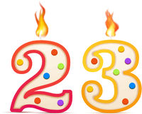 Twenty three years anniversary, 23 number shaped birthday candle with fire on white