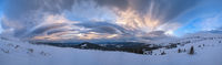 Picturesque winter windy and cloudy morning alps. Ukrainian Carpathians highest ridge is Chornohora with peaks of Hoverla and Petros mountains. View from Svydovets ridge  Dragobrat ski resort.