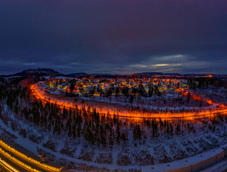 Winter with a city light illuminated landscape of the frozen season. Snowy town - Albstadt in germany at the popular swabian alb.