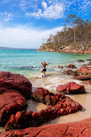 Woman playing in ocean paradise beach travel destination