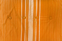 Background image of orange fabric from an old armchair. The texture of the fabric with stripes. Cover from an old chair lush lava.