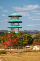 Japanese four-tier tower in the park in Autumn season